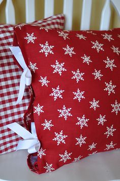 Christmas pillow covers from napkins... easy to change out for holiday decorating.