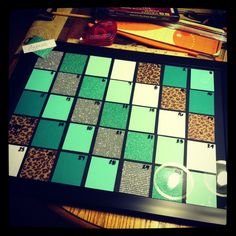 """Calendar made with scrapbook paper and an 18"""" x 14"""" picture frame. Use sharpie for the dry erase marker and use rubbing alcohol at the end of the month to remove the sharpie. So many different options :)"""