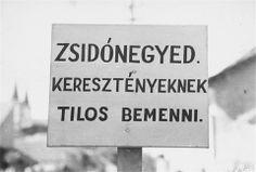 """A sign posted at the entrance to the Jewish quarter in Budapest. The Hungarian text reads, """"Entrance forbidden to Christians."""" 1944."""