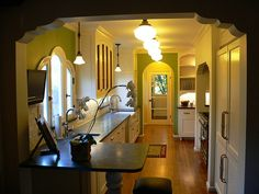1930s kitchen interior. Love the school house lights