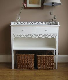 storage idea - baskets under table hide shoe clutter