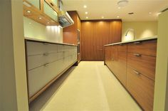 cabinets: Henrybuilt in walnut and laminate  counters: Caesarstone Blizzard  floors are a white terrazzo