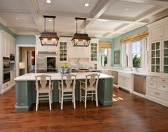 Love the teal accents in the kitchen with white counters/cabinets.  Hardwood floors and brown accents to bring in the natural quality