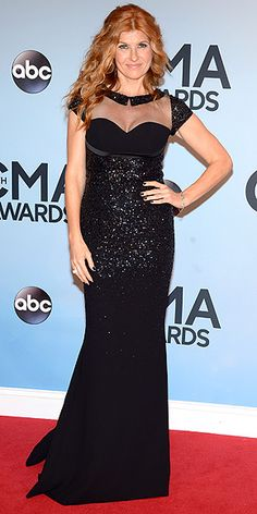 Rayna James – oops, we mean her real-life alter ego, Connie Britton – shows those country starlets how it's done in a formfitting, sequin black Georges Hobeika gown with a sweetheart neckline, sheer yoke and pilgrim collar. Oh, and that hair. Can't forget about the hair. http://www.people.com/people/package/gallery/0,,20316530_20753150,00.html#30048382