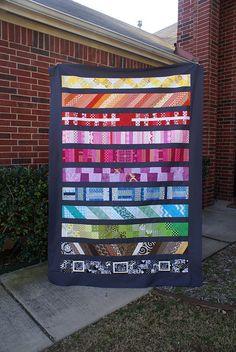 rainbow-striped quilt