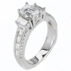 Details like baguette shape accent diamonds make unique engagement rings!  #engagement #engagementrings #jewelry #artdeco #weddings #uniqueengagementrings $6780