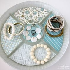 Repurpose an old serving tray into pretty storage for your jewelry.