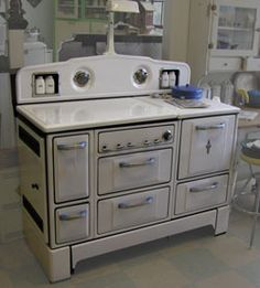 1935 white Wedgewood stove includes salt, pepper, sugar and flour shakers. Love this stove.