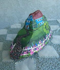 Unique house on hill--love the way the shape of this rock fits so well with the painting