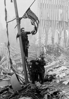This rare 9/11 photo of the first flag raised at #Groundzero wasn't released until ten years after September 11, 2001.  #9/11 9/11 Rescue workers following the collapse of #WorldTradeCenter Twin Towers (Two of the 4 Targets of #911) Remembering and Honoring the Heroes of 9-11-2001 9-11 #NeverForget #911 #Remembering911 9/11/2001