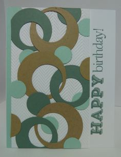 With the bit of shadow, I thought it was a herringbone background paper... I rather like that it turned out to be an embossing folder pattern.  The circles are fun!