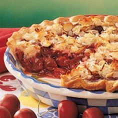 Macaroon Cherry Pie Recipe    This is my favorite pie recipe. I am ALWAYS asked to send this to my husband's company potlucks and make it for holiday dinners each year.     Think a sweet cherry pie with a crunchy, coconut-almond flavored top crust.     It's definitely a favorite in our house.
