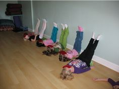 Children can stay with the feet up for two minutes. It helps kids get unstuck, gain focus, and relax.