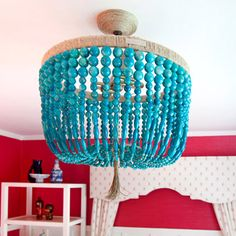 DIY beading around a light? would love to do this to a fan in the light center part... we have fan's in every room, figuring out how to dress them up.