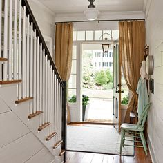 From Southern Living magazine a casual entryway with burlap curtains.