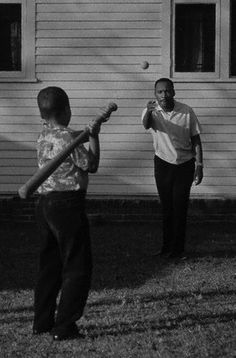 Dr. King playing ball with his son.