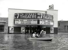 """This was taken during a flood in 1949 in front of the 7th Street Theatre in Fort Worth Texas, on the corner of 7th Street and University, known locally as """"Six Points"""". Photo by Lee Angle."""