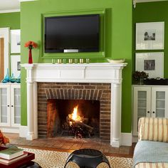 I love the green walls with the white mantle and brick fire place. love the way the brick was layed.