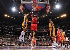 Samuel Dalembert dunks over Matt Barnes and the Lakers