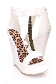 You will be head over heels for these saucy little numbers! They will perfectly compliment any outfit for any occasion! Make sure to add these to your collection, they definitely are a must have! The features for these wedges include a faux leather upper with a T strap center, high polish accents, open toe, stitched trim, back zipper closure, smooth lining, and cushioned footbed. Approximately 5 inch wedge heels and 1 1/2 inch platforms.
