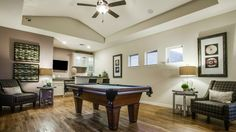 Create a sophisticated #gameroom with a built-in #bar area and plenty of space, perfect for challenging friends to #billiards while catching the #football #game.
