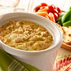 Slow Cooker Hot Golden Artichoke Dip - Entertaining tip: Keep dip warm by leaving the slow cooker on low during your party. #slowcooker #artichokedip #recipe