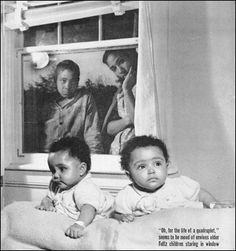 Two of the Fultz Quads, with an older sister and brother in the window. Their family was shunned from seeing them after they turned 7. From the Greensboro (NC) News-Record