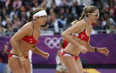 Kerri Walsh Jennings (R) and Misty May-Treanor of the U.S. arrive on court for their women's beach volleyball semifinal match