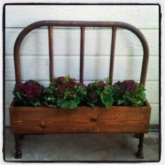 Planter made out of an old bed headboard.  How cute is this??!