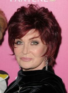 With its face-framing layers and rich ruby color, this bold shag hairstyle has become Sharon Osbourne's trademark look.More Hairstyles for Older Women:Short Haircuts Over 50Bob Hairstyles Over 4010 Perfect PonytailsShort Hair Over 40Red Hair Over 40Updos Over 40Bronde Hairstyles Over 40Dos and Don't...