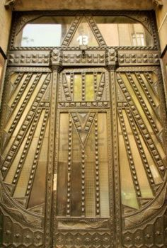Geometric design in wrought iron on the door of an Art Deco apartment house in Budapest
