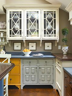 Classic Touch: Different, but Alike! A unique mixture. Cabinets in different styles are unified with related elements. All of the cabinets have similar architectural details, such as lattice work, dentil molding, and furniture styling. When mixing cabinet colors, include one or two neutral shades that will let bolder hues stand out.