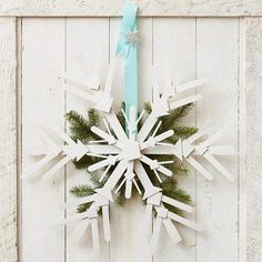 You'll use paint sticks to make this winter weather worthy wreath! More DIY ideas: http://www.bhg.com/christmas/decorating/diy-christmas-decorations/?socsrc=bhgpin121313snowflakewreath&page=4