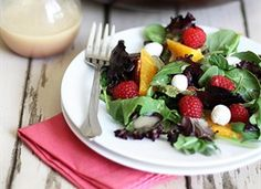 Spring Mix Salad with Raspberries -  Ingredients        6 ounces baby greens (such as red leaf lettuce, spinach, and arugula)      2 medium oranges      1 1/4 cup raspberries      1/4 cup whole almonds, lightly toasted      1/4 cup pecan halves, lightly toasted      6 ounces soft goat cheese  White Zinfandel Vinaigrette: 1/4 cup white zinfandel, 1 tablespoon orange juice, 1/3 cup canola oil, 2 teaspoons raspberry vinegar, 1 shallot, skin removed, 1/2 tsp sugar, 1/4 tsp white pepper, 1/4 tsp salt