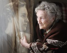 This is a portrait shot by a photographer of her grandmother at 21 on the left and 92 on the right, composited in Photoshop, 2011.