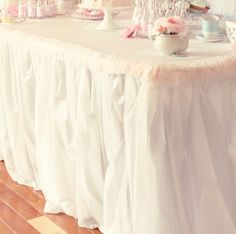 Plastic tablecloths: sew a seam and use twine to ruffle.