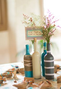 bottles and scripture with wildflowers for table numbers and centerpieces! #wedding #virginia #vintage #diy #budget #burlap