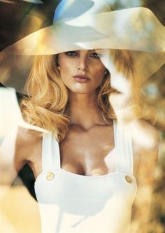 White... pretty hat - reminiscent of Sarah Moon of the 70's & 80's