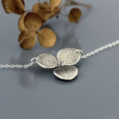 Hydrangea Blossom Necklace by Lisa Hopkins Design : a real hydrangea blossom is imprinted into sterling silver
