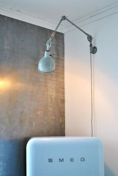 A smart solution for a lamp in a small kitchen.
