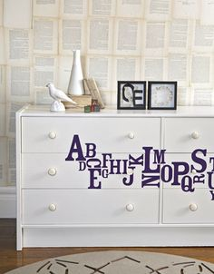 From a Country Living story.  Old dresser transformed with cream paint, Anthropologie handles, and decals from a fantastic french company, Harmonie Interieure.