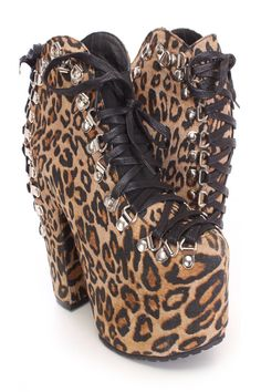 You will be head over heels for these saucy little numbers! They will perfectly compliment any outfit for any occasion! Make sure to add these to your collection, they definitely are a must have! The features for these booties include a faux suede upper with a lace up tie design on the front and back through metal D rings, stitched detailing, round closed toe, smooth lining, and cushioned footbed. Approximately 6 inch chunky heels and 2 1/2 inch covered platforms.