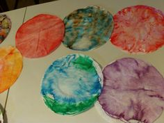 "Coffee filter planets - cool!  So easy, just washable markers, filters, and spray bottle of water.  Kids can write about a new planet they have ""discovered"" and then do this craft to post with their writing."