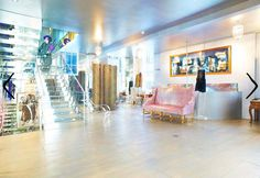 Le Louvre designer salon in South Yarra.  Love the pink sofa and the mirrored stairs.