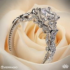 Verragio Braided 3 Stone Engagement Ring - INS-7074R - Verragio Insignia Collection. This designer engagement ring features 0.50ctw (F/G VS) round brilliant cut diamond melee to enhance a round diamond center of your choice. The width tapers from 2.7mm at the top down to 2.2mm at the bottom.