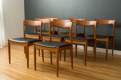 This is a set of eight vintage Mid-Century teak dining chairs marked Vamo  Sonderborg, Made in Denmark. The seats have been professionally  reupholstered in black faux leather. Two arm chairs are available  separately to make a set of ten.  $3600/SET  MIDCENTURY MODERN FINDS