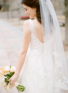 classic veil with lace, photo by Laura Ivanova http://ruffledblog.com/spring-minneapolis-wedding #weddingaccessories #veils