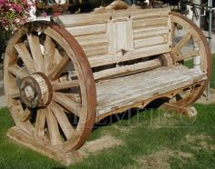 This antique wooden bench is manufactured from a pair of original old doors that are about 150 years old and a pair of authentic wagon cart wheels. Ask us about our collection of Antiques that we carry