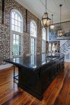 black kitchen island and brick wall design