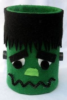 Tin Can Frankenstein. So many formula cans in my closet stored up for such ideas.....anyone need one?